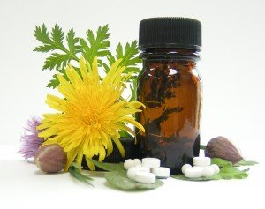 Shot of pills and brown bottle with yellow flower